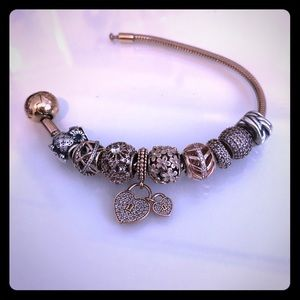 Rose gold pandora bracelet (charms included)